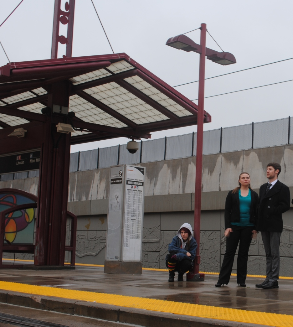 Photo shoot with the cast of The Man with the Good Face at the University of Denver light rail station. From left to right: the homeless woman (Sonora Dolce), Anna (Emily Gradowski), and James Neal (Blake Nawa'a)