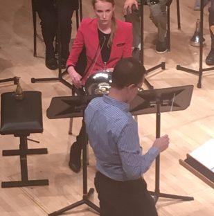 "Briay Conditt bowing her horn in ""Vantablack"""